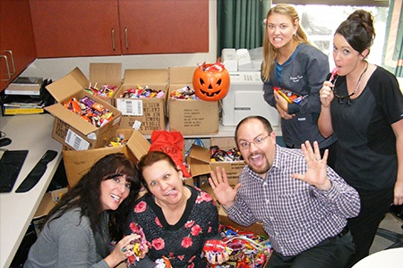 Team members at Halloween candy buy back