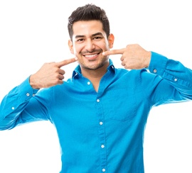 A man pointing at his smile