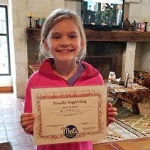 Child holding cavity-free certificate