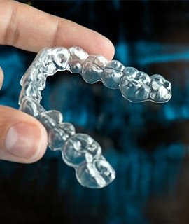 person holding clear aligner