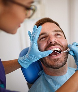 Patient receiving dental exam