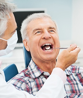 Older man receiving a dental exam