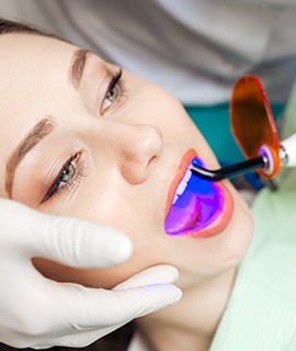 Woman receiving dental sealants