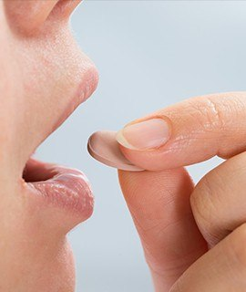 Woman taking her oral sedation pill