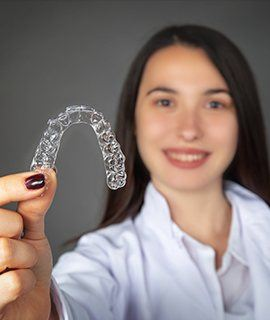 Patient holding an Invisalign tray
