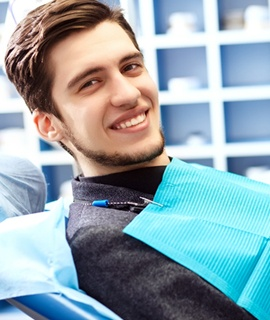 young man smiling dentist chair