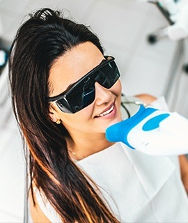 Woman receiving teeth whitening treatment